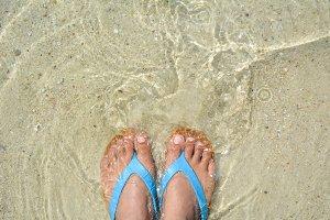 feet women and sandal on the beach