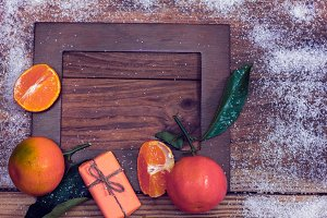 art frame with tangerines and gift