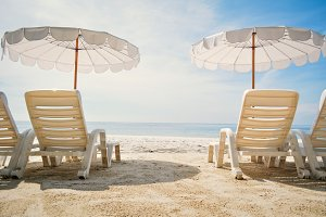 chair with sun umbrella in the beach