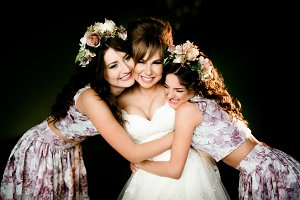 Bridesmaids in dresses with flowers