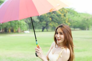 Woman with umbrella standing on the