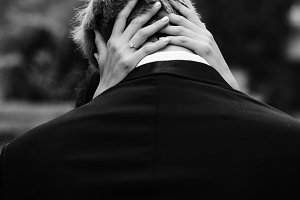 A look from behind on a man kissing