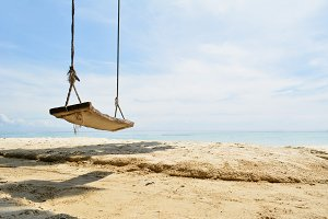 wooden swing  on beautiful beach