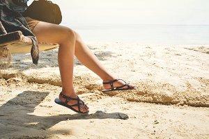 leg women sitting in swing on beach