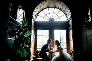 Lovely wedding couple sits in cafe