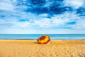 Orange umbrella on a beach