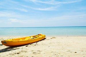 Yellow kayak in the beach on seafron