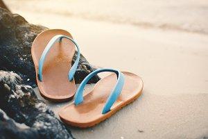 Blue sandal on the beach