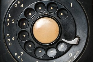Close up of old rotary dial on telephone