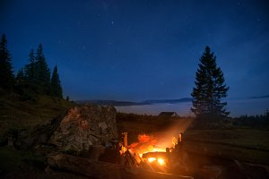 Campfire under blue night sky
