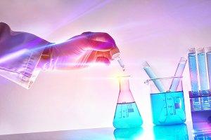 Hand of laboratory worker lights