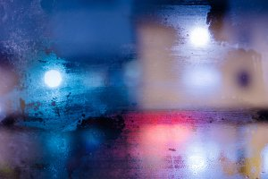 abstract texture night city behind the glass