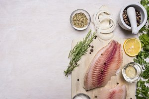 raw fillet of tilapia with spices
