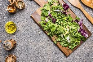 Cooking vegetarian salad with herbs