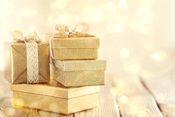 Beautiful golden gifts on wooden