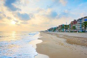 Spain sea beach town at sunset