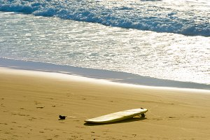 Surfboard laying on a beach