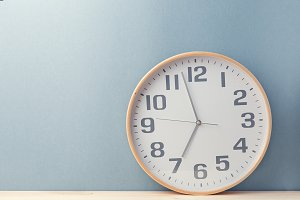 Clock showing time on blue backgroun