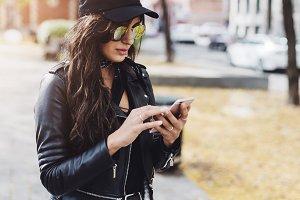 Stylish girl using smartphone