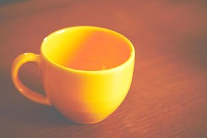 Empty yellow cup of coffee