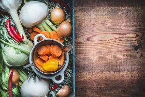 Organic vegetables box on wooden