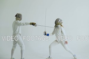 Two fencers having training attack exercises in fencing on white background
