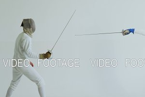 Two fencers having training attack and defence exercises in fencing on white background