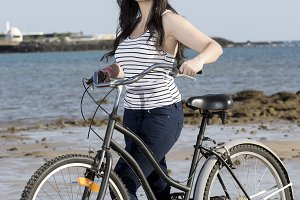 Young female with bike in Lanzarote