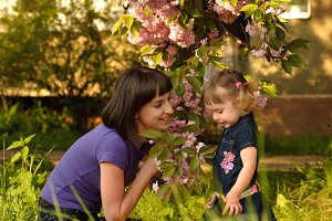 Little girl in garden with mother