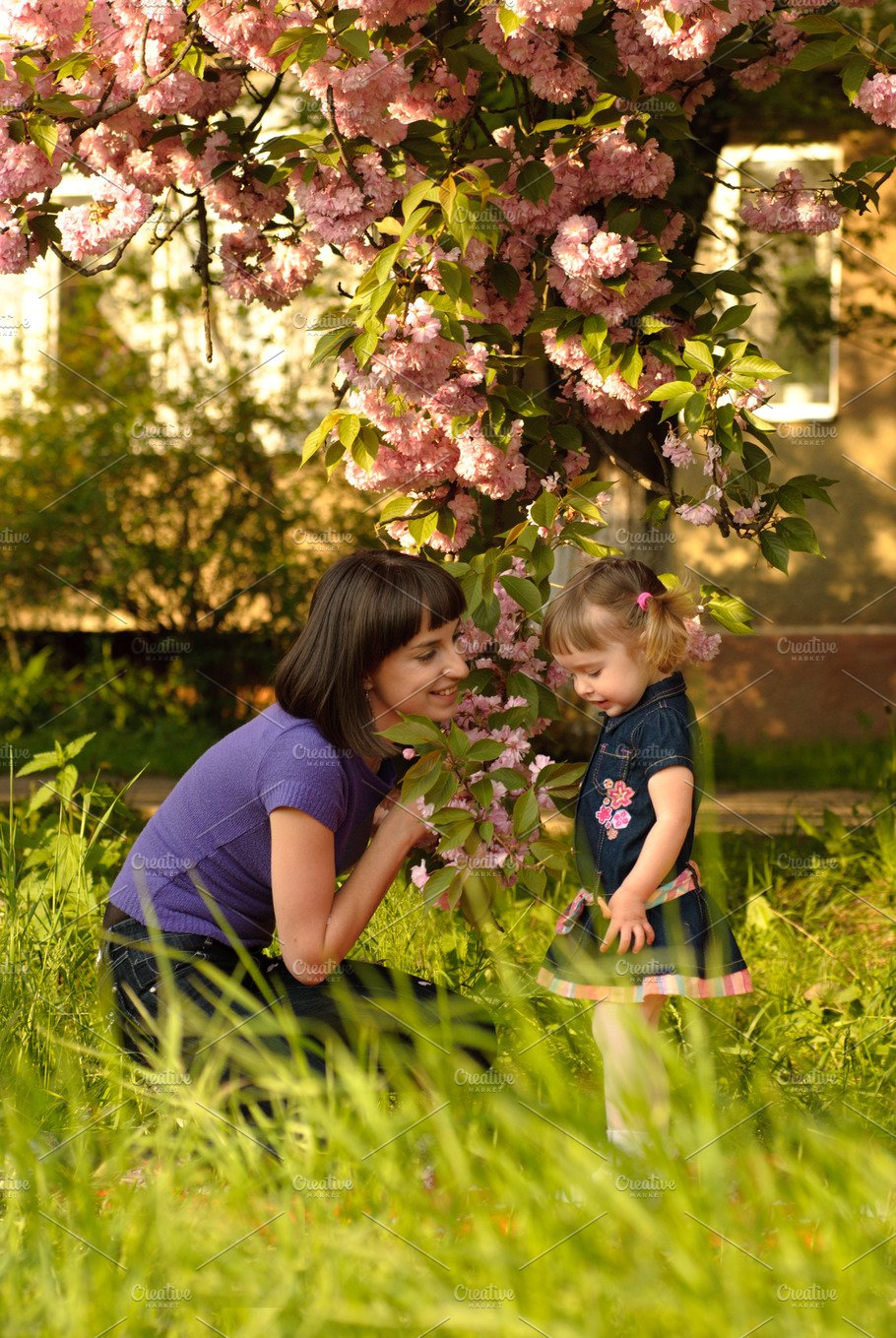 Little girl in garden with mother - Nature Photos | Creative Market Pro