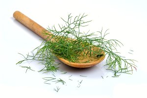 Wooden spoon with dill