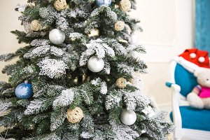 Luxurious snow-covered pine tree