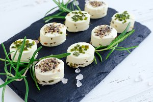Mini appetizers from soft cheese with spices