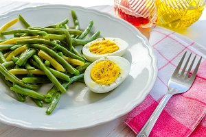 Cooked green beans with boiled eggs