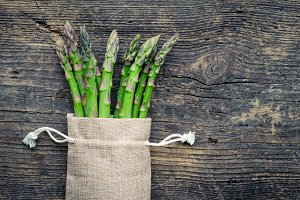 Bunch of asparagus in burlap bag
