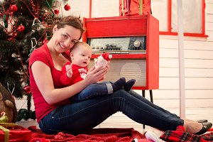 Mother with baby in Christmas time