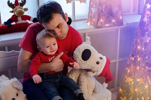 Father with baby in Christmas time