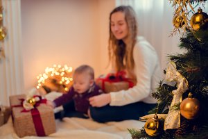 Christmas scene with happy family in blurred background