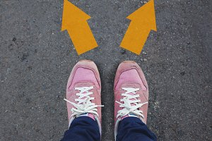 Pair of shoes standing on road with