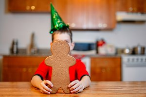 boy holding a gingerbread man