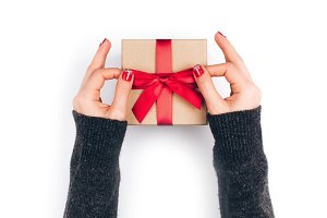 Woman's hands with gift box