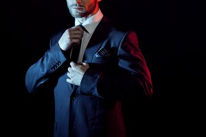 serious man in a business suit, dark