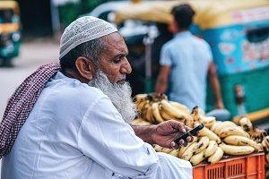 Muslim Man Selling Banannas On The S