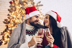 Christmas couple cheers together