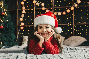Cheerful girl in Santa Claus hat