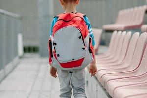 Boy walking alone to a school