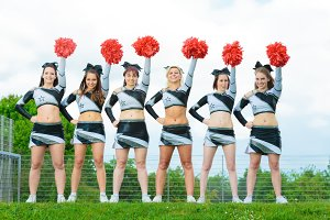 Cheerleaders Rooting For Their Team