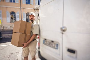Messenger Delivering Parcel, Standing Next To His Van