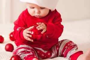 Baby with Christmas ball