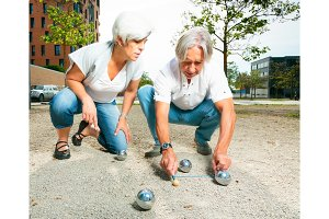 Senior Couple Playing A Game Of Boule